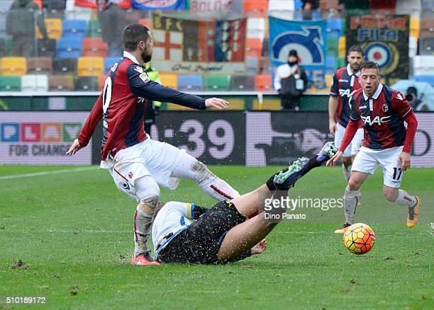 Danilo Larangeira of Udinese Calcio competes with Mattia Destro of Bologna FC during the Serie A match between Udinese Calcio and Bologna FC at...