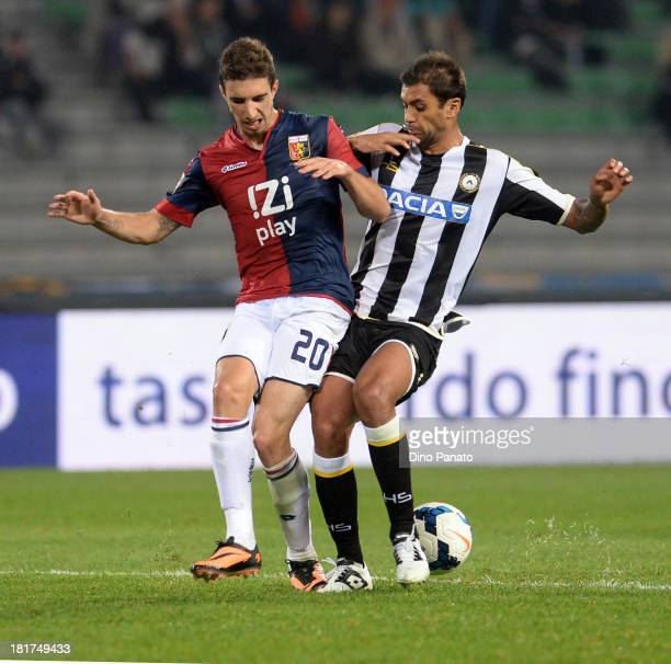 Danilo Larangeira of Udinese Calcio competes with Sime Vrsaljko of Genoa CFC during the Serie A match between Udinese Calcio and Genoa CFC at Stadio...