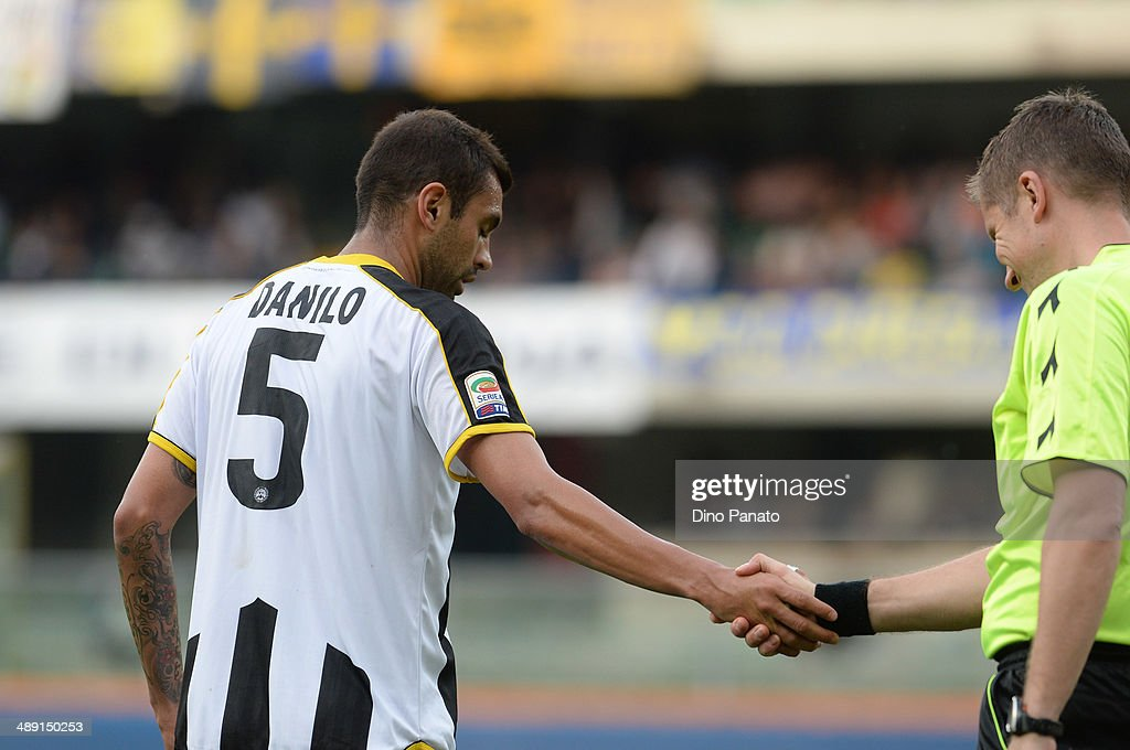 Danilo Larangeira of Udinese Calcio shakes hands with Daniele Orsato assistant referee during the Serie A match between Hellas Verona FC and Udinese Calcio at Stadio Marc'Antonio Bentegodi on May 10, 2014 in Verona, Italy.