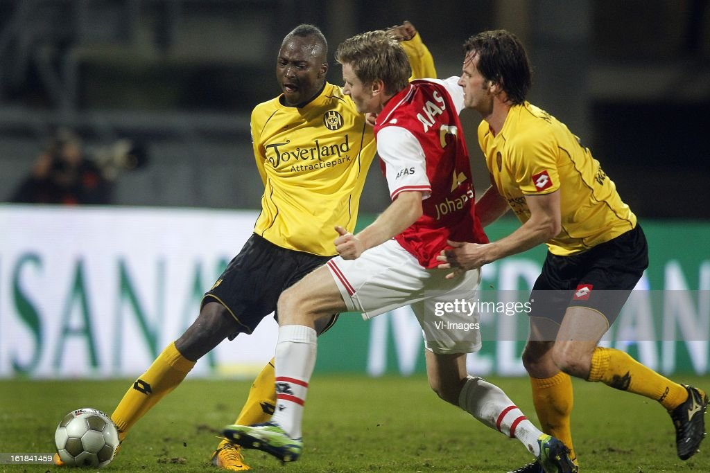 Danilo Luis Helio Pereira of Roda JC (L), Mattias Johansson of AZ (C), Rob Wielaert of Roda JC (R) during the Dutch Eredivisie match between Roda JC Kerkrade and AZ Alkmaar at the Parkstad Limburg Stadium on february 16, 2013 in Kerkrade, The Netherlands