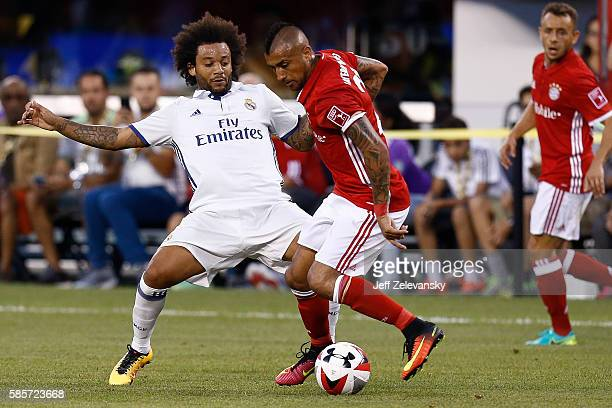 Danilo Luiz Da Silva of Real Madrid fights for the ball with Arturo Vidal of Bayern Munich during their International Champions Cup match at MetLife...