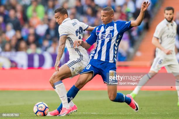 Danilo Luiz Da Silva of Real Madrid fights for the ball with Deyverson Brum Silva Acosta of Deportivo Alaves during their La Liga match between Real...