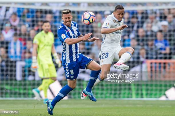 Danilo Luiz Da Silva of Real Madrid fights for the ball with Victor Camarasa Ferrando of Deportivo Alaves during their La Liga match between Real...