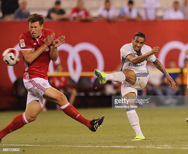 Danilo Luiz Da Silva of Real Madrid scores his first goal against Nicolas Feldhahn of Bayern Muenchen during the International Champions Cup match...