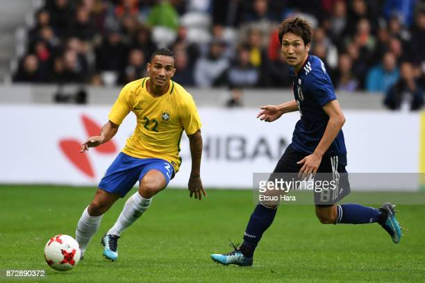 Danilo of Brazil and Genki Haraguchi of Japan compete for the ball during the international friendly match between Brazil and Japan at Stade...