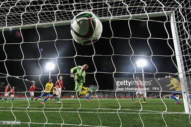 Danilo of Brazil heads and scores his teams first goal of the game past goalkeeper Gyorgy Szekely of Hungary during the FIFA U20 World Cup New...