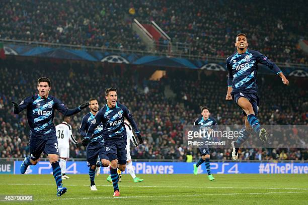 Danilo of FC Porto celebrates with teammates after scoring his team's first goal during the UEFA Champions League Round of 16 match between FC Basel...