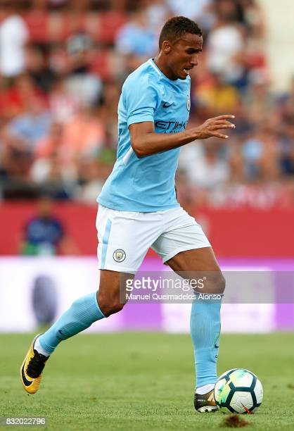 Danilo of Manchester City runs with the ball during the preseason friendly match between Girona and Manchester City at Municipal de Montilivi Stadium...