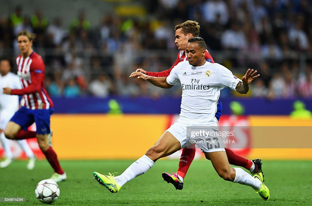 Danilo of Real Madrid blocks the way of Antoine Griezmann of Atletico Madrid during the UEFA Champions League Final between Real Madrid and Club Atletico de Madrid at Stadio Giuseppe Meazza on May 28, 2016 in Milan, Italy..