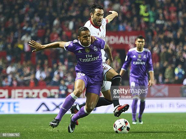 Danilo of Real Madrid CF competes for the ball with Vicente Iborra of Sevilla FC during the Copa del Rey Round of 16 Second Leg match between Sevilla...