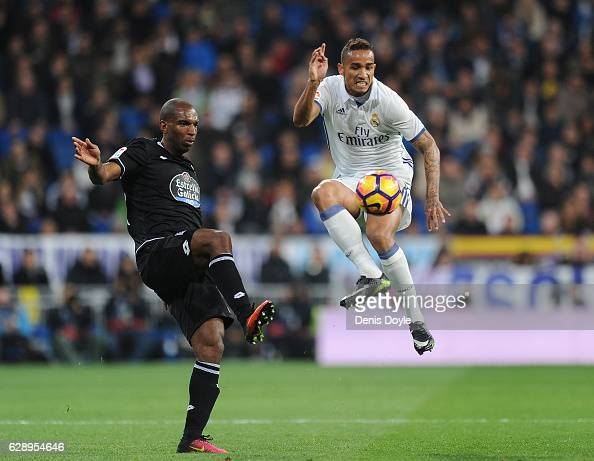 Danilo of Real Madrid CF fights for the ball against Ryan Babel of RC Deportivo la Coruna during the La Liga match between Real Madrid CF and RC...