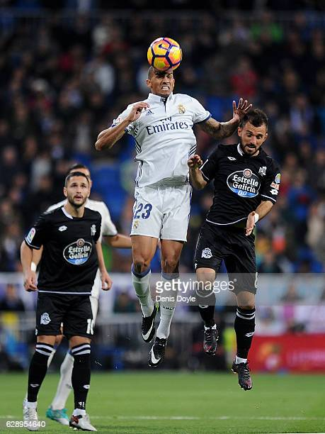 Danilo of Real Madrid CF heads the bll beside Emre Colak of RC Deportivo la Coruna during the La Liga match between Real Madrid CF and RC Deportivo...