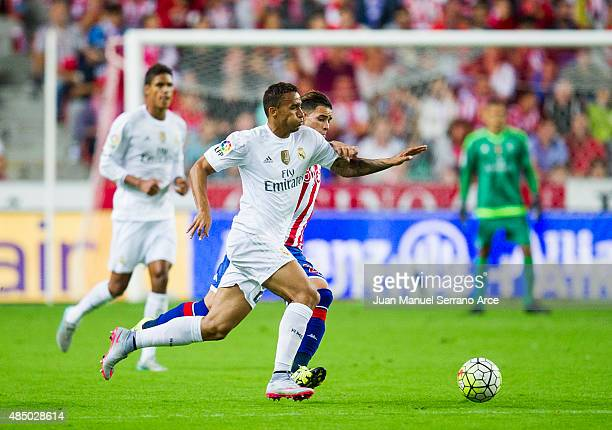 Danilo of Real Madrid duels for the ball with Arnaldo Sanabria of Real Sporting de Gijon during the La Liga match between Sporting Gijon and Real...