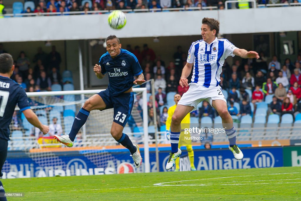 Danilo of Real Madrid duels for the ball with Oyarzabal of Real Sociedad during the Spanish league football match between Real Sociedad and Real Madrid at the Anoeta Stadium in San Sebastian on April 30, 2016