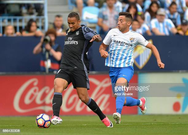 Danilo of Real Madrid is chased down by Jony of Malaga during the La Liga match between Malaga and Real Madrid at La Rosaleda Stadium on May 21 2017...