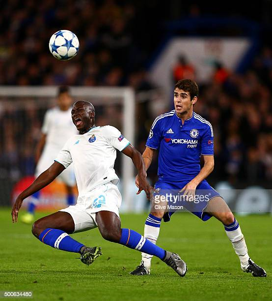 Danilo Pereira of FC Porto is tackled by Oscar of Chelsea during the UEFA Champions League Group G match between Chelsea FC and FC Porto at Stamford...