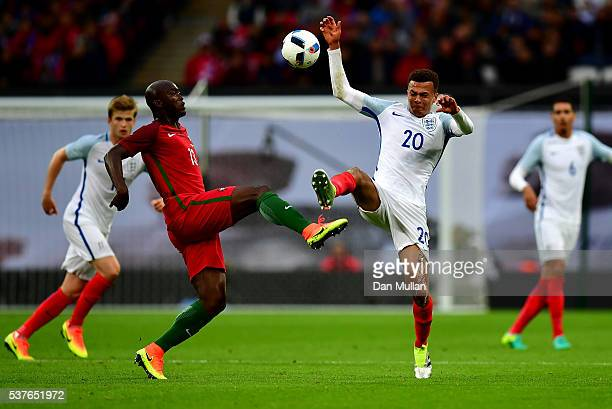 Danilo Pereira of Portugal highkicking with Dele Alli of England during the international friendly match between England and Portugal at Wembley...
