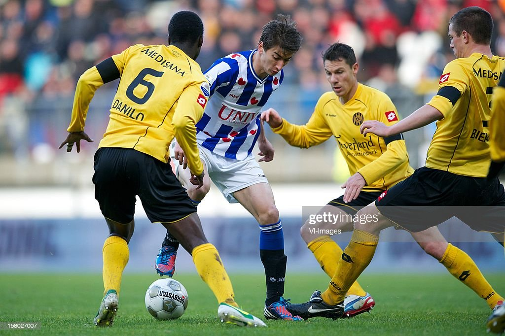 Danilo Pereira of Roda JC Kerkrade, Filip Djuricic of SC Heerenveen, Mark-Jan Fledderus of Roda JC Kerkrade, Bart Biemans of Roda JC Kerkrade during the Dutch Eredivisie match between SC Heerenveen and Roda JC Kerkrade at the Abe Lenstra Stadium on December 09, 2012 in Heerenveen, The Netherlands.