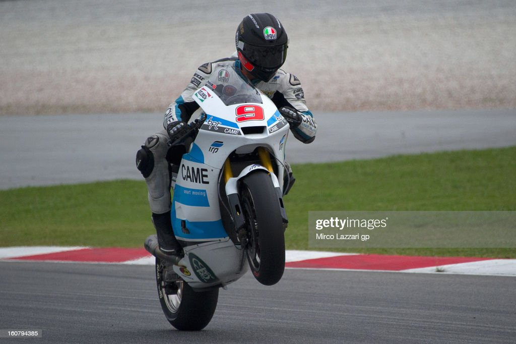 Danilo Petrucci of Italy and Came Iodaracing Project lifts the front wheel during the MotoGP Tests in Sepang - Day Four at Sepang Circuit on February 6, 2013 in Kuala Lumpur, Malaysia.