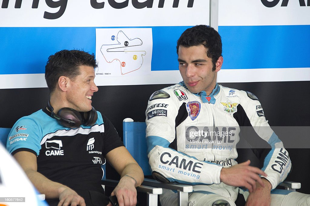 Danilo Petrucci of Italy and Came Iodaracing Project speaks with his mechanic during day one of CRT Tests for the MotoGP at Sepang Circuit on February 3, 2013 in Kuala Lumpur, Malaysia.