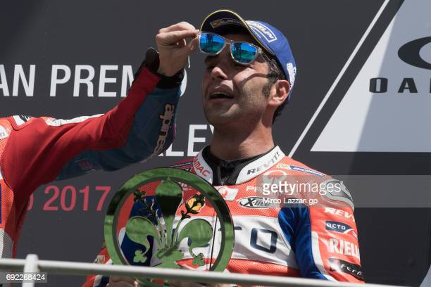 Danilo Petrucci of Italy and Octo Pramac Yakhnich celebrates the third place and cries on the podium at the end of the MotoGP race during the MotoGp...