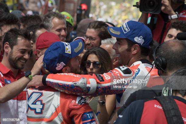 Danilo Petrucci of Italy and Octo Pramac Yakhnich celebrates with Andrea Dovizioso of Italy and Ducati Team at the end of the MotoGP race during the...