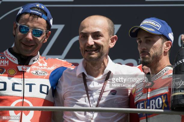 Danilo Petrucci of Italy and Octo Pramac Yakhnich Claudio Domenicali of Italy and Andrea Dovizioso of Italy and Ducati Team celebrate on the podium...