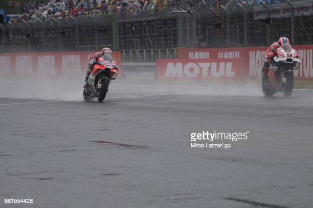 Danilo Petrucci of Italy and Octo Pramac Yakhnich leads Andrea Dovizioso of Italy and Ducati Team during the end of the MotoGP race during the MotoGP...