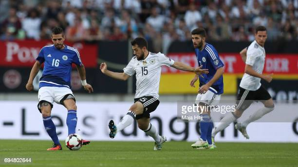Danilo Rinaldi of San Marino Amin Younes and Matteo Vitaioli of San Marino battle for the ball during the FIFA 2018 World Cup Qualifier between...
