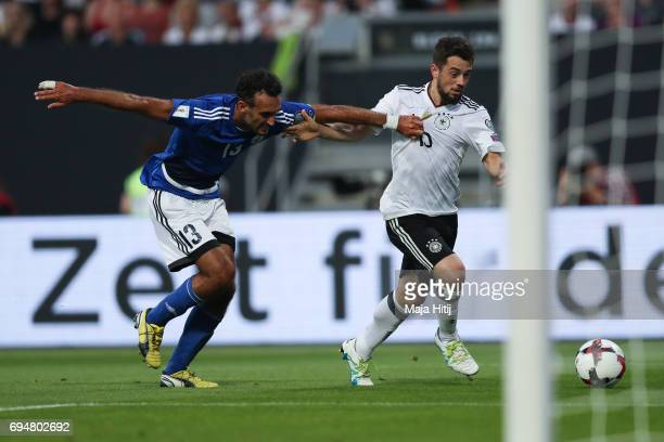 Danilo Rinaldi of San Marino and Amin Younes of Germany battle for the ball during the FIFA 2018 World Cup Qualifier between Germany and San Marino...