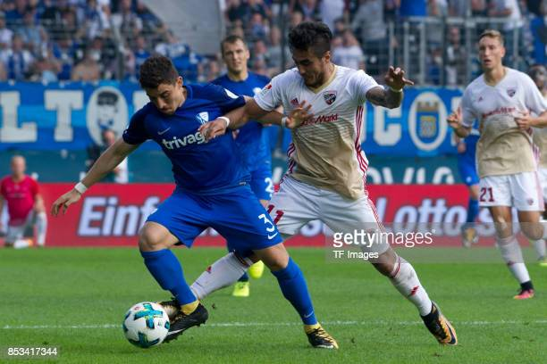 Danilo Soares of Bochum and Dario Lezcano of Ingolstadt battle for the ball during the Second Bundesliga match between VfL Bochum 1848 and FC...