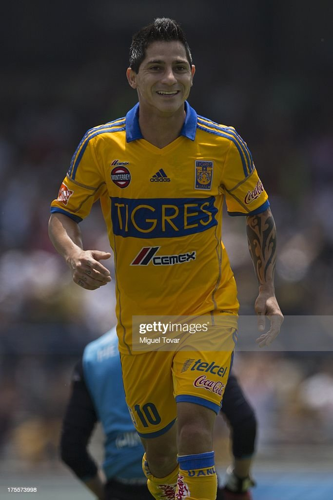Danilo Veron celebrates after scoring during a match between Pumas and Tigres as part of the league MX at Olympic stadium, on August 04, 2013 in Mexico City, Mexico.