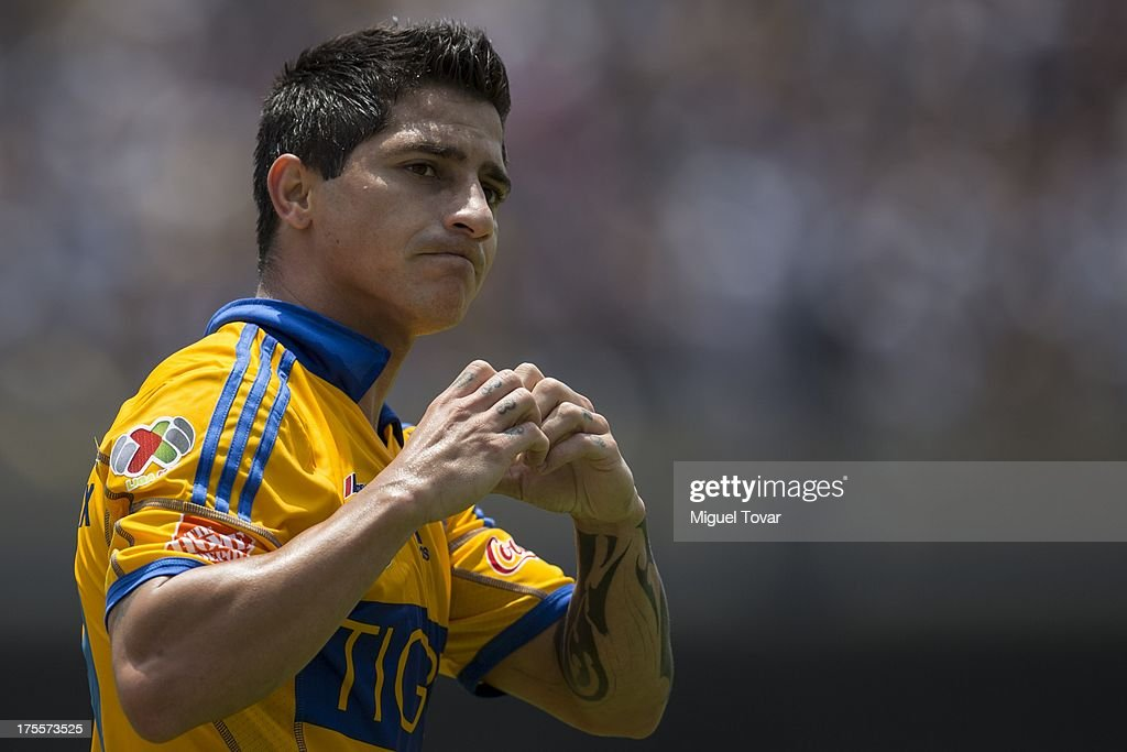 Danilo Veron of Tigres celebrates after scoring during a match between Pumas and Tigres as part of Apertura 2013 of Liga MX at Olympic stadium on August 04, 2013 in Mexico City, Mexico.
