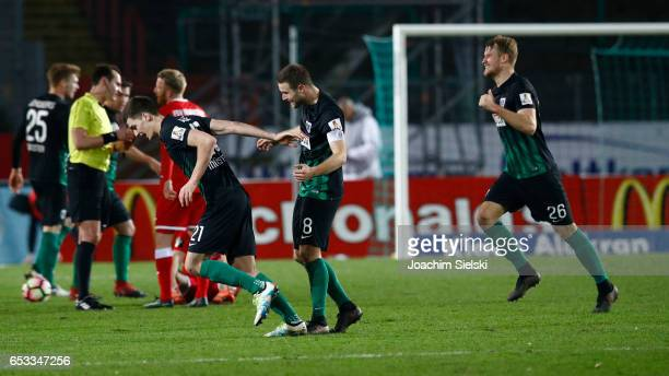 Danilo Wiebe Michele Rizzi and Sebastian Mai of Muenster celebrate after the third league match between Preussen Muenster and FSV Frankfurt at...