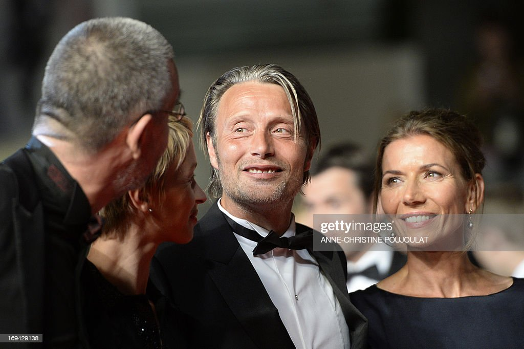 Danish actor Mads Mikkelsen (C) and his wife Hanne Jakobsen (R) arrive on May 24, 2013 for the screening of the film 'Michael Kohlhaas' presented in Competition at the 66th edition of the Cannes Film Festival in Cannes. Cannes, one of the world's top film festivals, opened on May 15 and will climax on May 26 with awards selected by a jury headed this year by Hollywood legend Steven Spielberg. AFP PHOTO / ANNE-CHRISTINE POUJOULAT