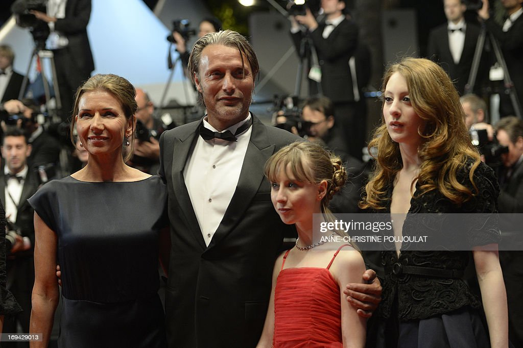 Danish actor Mads Mikkelsen and his wife Hanne Jakobsen, French actress Melusine Mayance and French-Austrian actress Roxane Duran pose on May 24, 2013 as they arrive for the screening of the film 'Michael Kohlhaas' presented in Competition at the 66th edition of the Cannes Film Festival in Cannes. Cannes, one of the world's top film festivals, opened on May 15 and will climax on May 26 with awards selected by a jury headed this year by Hollywood legend Steven Spielberg. AFP PHOTO / ANNE-CHRISTINE POUJOULAT