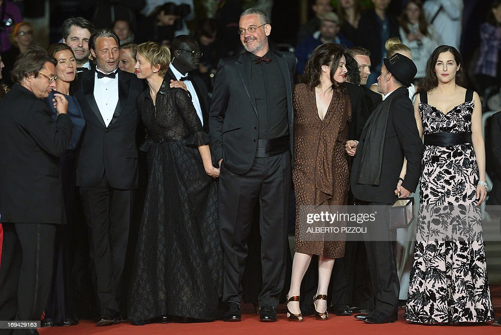 Danish actor Mads Mikkelsen and his wife Hanne Jakobsen, French actress Delphine Chuillot, French director Arnaud des Pallieres and his partner, French actor Denis Lavant and actress Amira Casar pose on May 24, 2013 as they arrive for the screening of the film 'Michael Kohlhaas' presented in Competition at the 66th edition of the Cannes Film Festival in Cannes. Cannes, one of the world's top film festivals, opened on May 15 and will climax on May 26 with awards selected by a jury headed this year by Hollywood legend Steven Spielberg. AFP PHOTO / ALBERTO PIZZOLI