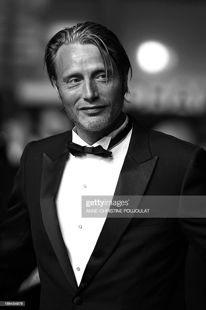 Danish actor Mads Mikkelsen arrives on May 24, 2013 for the screening of the film 'Michael Kohlhaas' presented in Competition at the 66th edition of the Cannes Film Festival in Cannes. Cannes, one of the world's top film festivals, opened on May 15 and will climax on May 26 with awards selected by a jury headed this year by Hollywood legend Steven Spielberg. AFP PHOTO / ANNE-CHRISTINE POUJOULAT