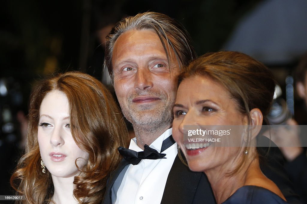 Danish actor Mads Mikkelsen (C) arrives on May 24, 2013 with his wife Hanne Jakobsen (R) and French-Austrian actress Roxane Duran for the screening of the film 'Michael Kohlhaas' presented in Competition at the 66th edition of the Cannes Film Festival in Cannes. Cannes, one of the world's top film festivals, opened on May 15 and will climax on May 26 with awards selected by a jury headed this year by Hollywood legend Steven Spielberg.