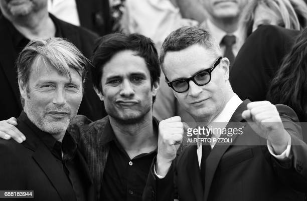 danish actor Mads Mikkelsen Mexican actor Gael Garcia Bernal and Danish director Nicolas Winding Refn pose on May 23 2017 during a photocall for the...