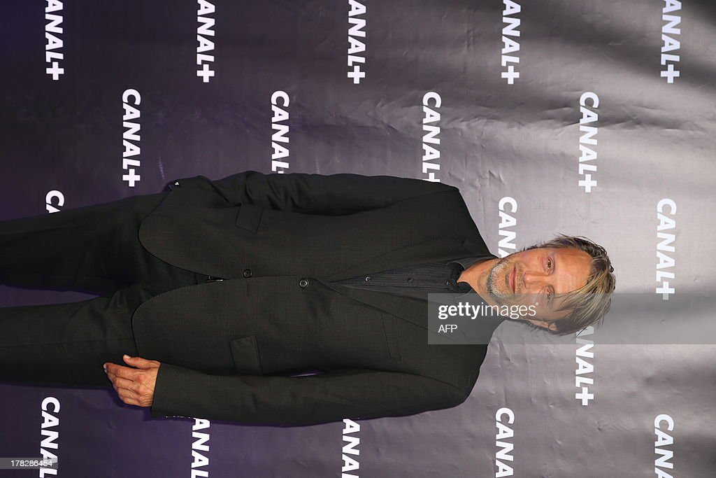 Danish actor Mads Mikkelsen poses in a photocall during the Canal+ new season's launching evening on August 28, 2013 in Paris. AFP PHOTO / THOMAS SAMSON