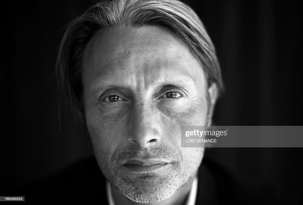 Danish actor Mads Mikkelsen poses on May 24, 2013 during a photo shoot on the sidelines of the 66th edition of the Cannes Film Festival in Cannes. Cannes, one of the world's top film festivals, opened on May 15 and will climax on May 26 with awards selected by a jury headed this year by Hollywood legend Steven Spielberg. AFP PHOTO / LOIC VENANCE