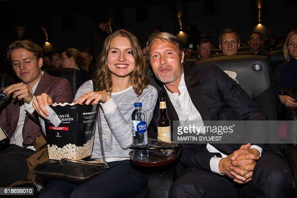 Danish actor Mads Mikkelsen (R) poses with his daughter ...