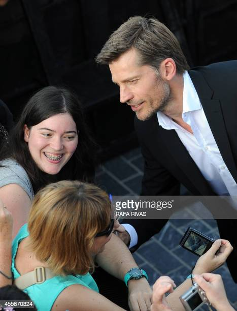 Danish actor Nikolaj CosterWaldau who plays the character of Jaime Lannister in Game of Thrones signs autographs after the screening of his film 'En...