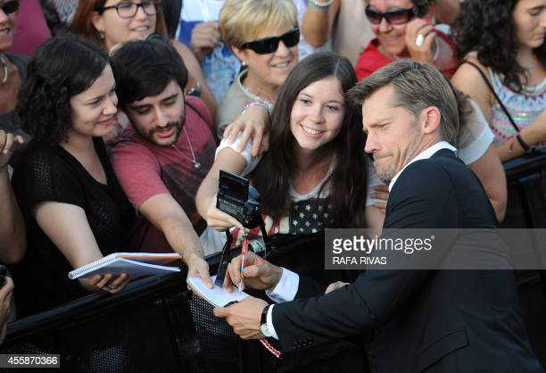Danish actor Nikolaj CosterWaldau who plays the character of Jaime Lannister in Game of Thrones poses as he signs autographs after the screening of...