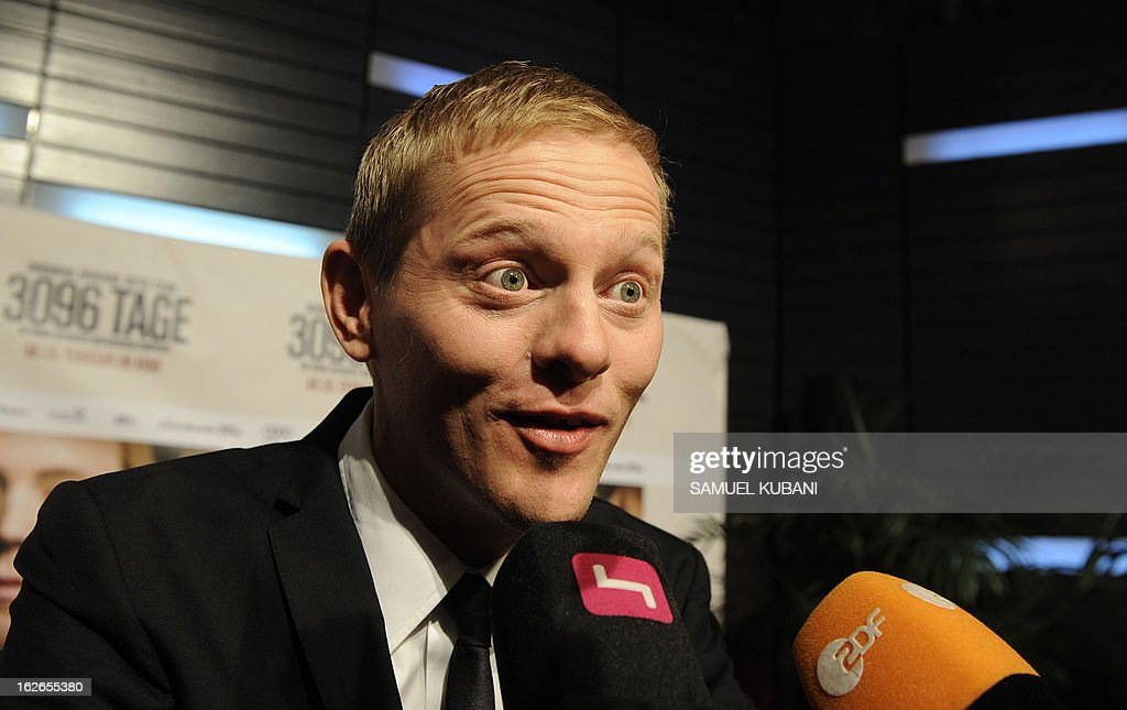 Danish actor Thure Lindhardt talks with journalists as he arrives for the premiere of the film '3,096 Days' based on the story of Austrian kidnap victim Natascha Kampusch on February 25, 2013 in Vienna.
