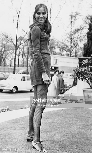 Danish actress Anna Karina pictured wearing a sweater dress as she poses for the cameras in Park Lane London before the gala premiere of her film...