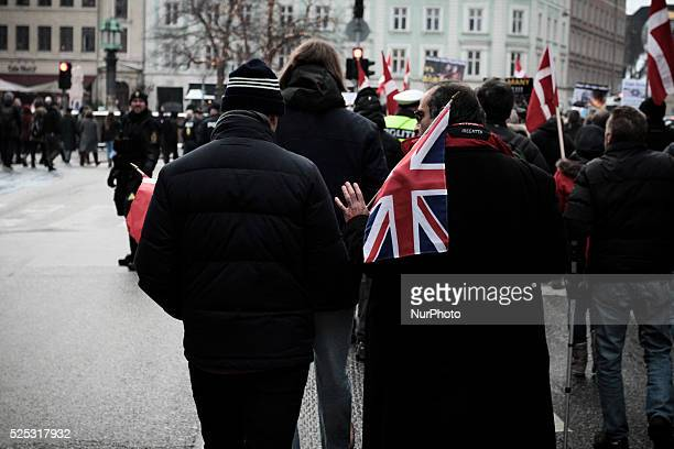 Danish and English PEGIDA activists walk side by side through Copenhagen's central shopping district Clashes between antiislamist protesters and...