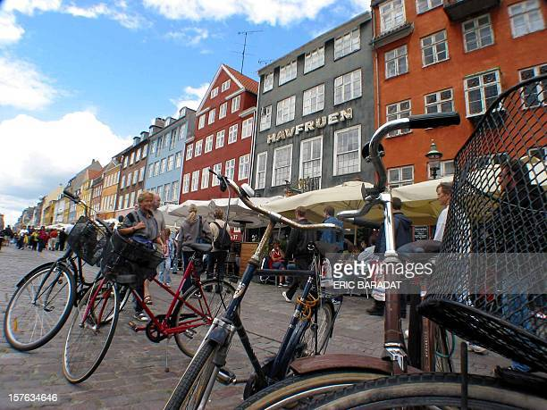 Danish and foreign tourists enjoy a walk near Copenhagen Nyhavn's ancient harbour 24 July 2002 Nyhavn is one of the main tourist attraction in the...