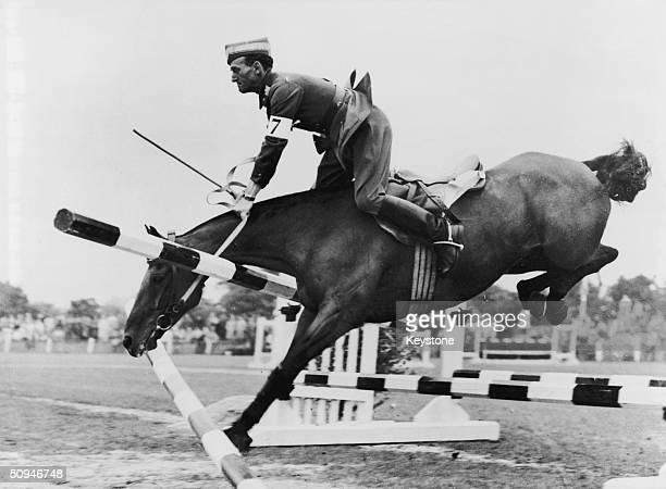 Danish competitor Major N Mikkelsen fails to win the Jumping Test event as his horse St Hans demolishes a fence 13th August 1948 The Test was part of...